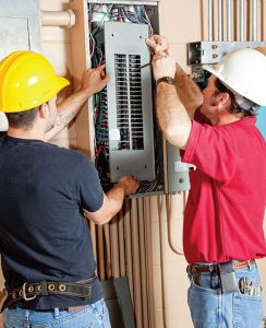 Two_electricians_in_panel